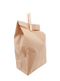 Old style paper lunch bag closed. With clothespin Stock Images