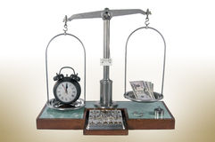 Old style pharmacy scale with clock heavier than money Royalty Free Stock Photography