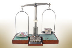 Old style pharmacy scale with drugs heavier than money Stock Photo