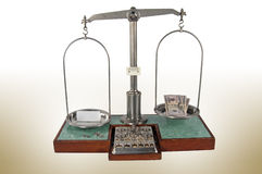 Old style pharmacy scale with small box heavier than money Stock Photo