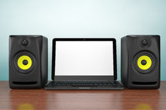 Old Style Photo. Audio Speakers with Laptop Royalty Free Stock Images