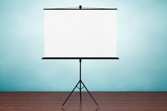 Old Style Photo. Blank Projection Screen. On the table Stock Images