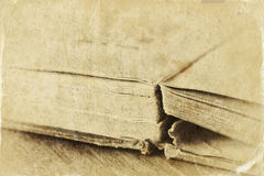 Old style photo of book detail with texture and sepia tone Stock Photos