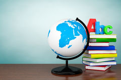Old Style Photo. Books with ABC sign and World desktop globe Stock Photos