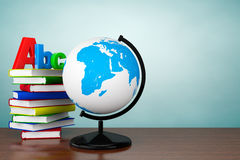 Old Style Photo. Books with ABC sign and World desktop globe Stock Images