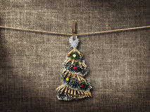 Old style photo  and Christmas tree hanging on a clothesline Royalty Free Stock Image