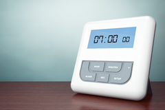 Old Style Photo. Digital Alarm Clock with LCD Display Stock Photos
