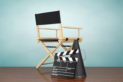 Old Style Photo. Director Chair, Movie Clapper and Megaphone. On the floor Royalty Free Stock Photography