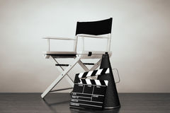 Old Style Photo. Director Chair, Movie Clapper and Megaphone. On the floor Stock Images