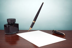 Old Style Photo. Fountain Pen with Ink Bottle and paper Royalty Free Stock Images