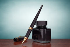 Old Style Photo. Fountain Pen with Ink Bottle Royalty Free Stock Photography