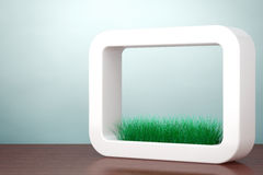 Old Style Photo. Grass in White Ceramics Planter. 3d rendering Stock Images