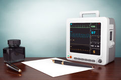 Old Style Photo. Health care portable cardiac monitoring equipment Stock Images