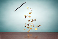 Old Style Photo. Magic wand casting shiny golden stars Stock Photography