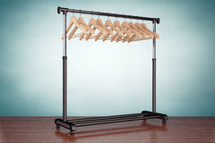 Old Style Photo. Mobile black coat rack with hangers. On the table Stock Photo