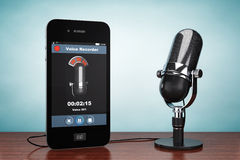 Old Style Photo. Mobile Phone as Voice Recorder with Microphone Stock Photo