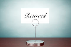 Old Style Photo. Note Paper Card Holder with Reserved Sign Royalty Free Stock Photos