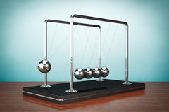 Old Style Photo. Perpetual Motion Spheres of Newton. On the table Royalty Free Stock Images