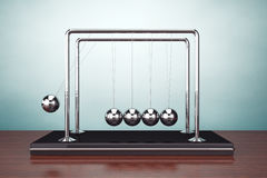 Old Style Photo. Perpetual Motion Spheres of Newton. On the table Royalty Free Stock Photos