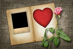 Old-style photo  with red paper heart with pink rose Stock Photos