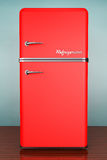 Old Style Photo. Retro refrigerator. On the floor Royalty Free Stock Photo