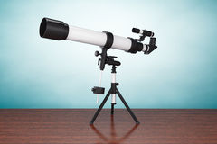 Old Style Photo. Silver Telescope on Tripod Stock Photography