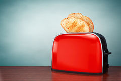 Old Style Photo. Toast popping out of Vintage Red Toaster Royalty Free Stock Photos