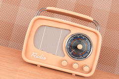 Old Style Photo. Vintage Radio on table. Front wall background Royalty Free Stock Images
