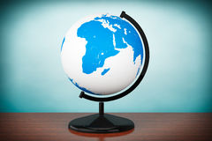 Old Style Photo. World desktop globe Royalty Free Stock Photo