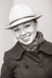 Old style photo with young woman in coat and hat Royalty Free Stock Photography