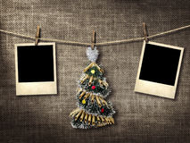 Old style photographs and Christmas tree hanging on a clotheslin Stock Photos