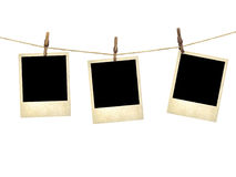 Old style photographs hanging on a clothesline. Isolated on white background royalty free stock photos