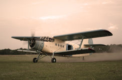 Old style plane flying up Stock Image