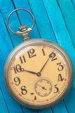 Old style pocket watch on wooden backround Royalty Free Stock Photo