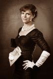 Old style portrait of woman with newspaper. Old style woman with newspaper and white gloves Royalty Free Stock Images