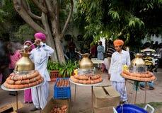 Old style Rajasthan men prepare tea masala Stock Photography