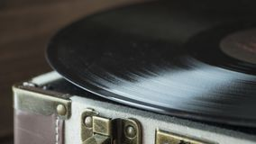 Old style record player of vinyl disc with needle and plate, home cozy evening mood stock photo