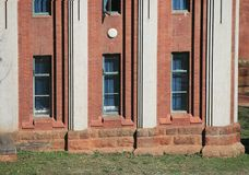 OLD STYLE RED BRICK AND WHITE PAINTED BUILDING Stock Photography