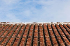 Old style roof tile and blue sky Stock Photography