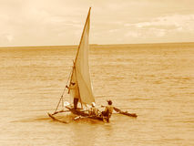 Old Style Sailing on a Dhow. A dhow sails on the Indian Ocean off the coast of Zanzibar, Tanzania Royalty Free Stock Photo