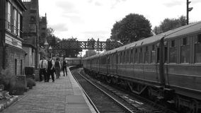 Old style shot of platform in B&W with traditional carriages 4K stock video