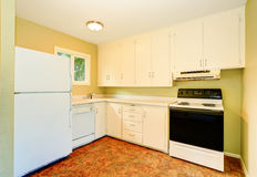 Old style simple kitchen interior with white cabinets. Old style simple kitchen interior with cabinets and white appliances. Northwest, USA Stock Photography