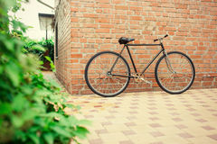 Old style singlespeed bicycle against brick wall Royalty Free Stock Image