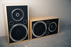 Old style stereo speakers on concrete floor. Close up stock photo