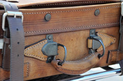 Old style suitcases outdoors. Old brown leather suitcase with straps Stock Photography