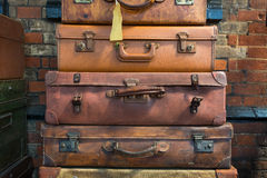 Old style suitcases ready for loading. Closeup of vintage leather suitcases Royalty Free Stock Images