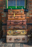 Old style suitcases ready for loading. Vintage leather suitcases stacked one on top of each other ready for loading Stock Photography