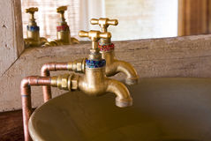 Old style taps Royalty Free Stock Photography