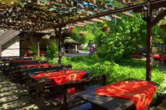 Old style tavern outdoor seating Stock Photos