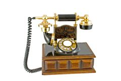 Old Style Telephone. On a wooden base with a white background royalty free stock photos